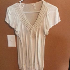 Cream colored flutter sleeve top